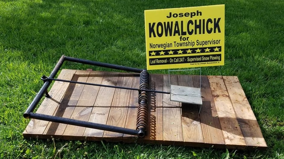 Joseph Kowalchick built a human-sized rat trap to deter would-be thieves from stealing his campaign signs.
