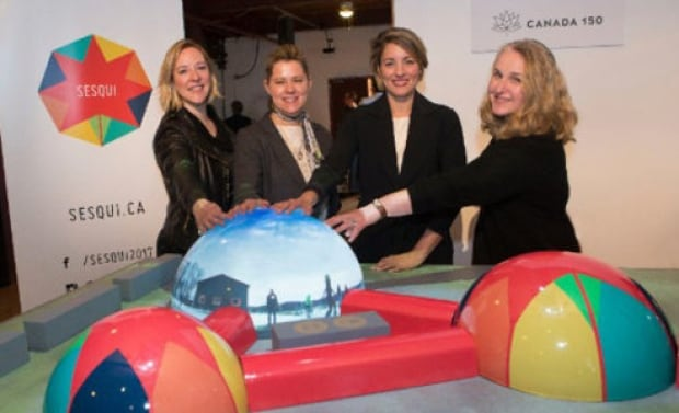 "Heritage Minister Melanie Joly shows model of touring ""dome village"""
