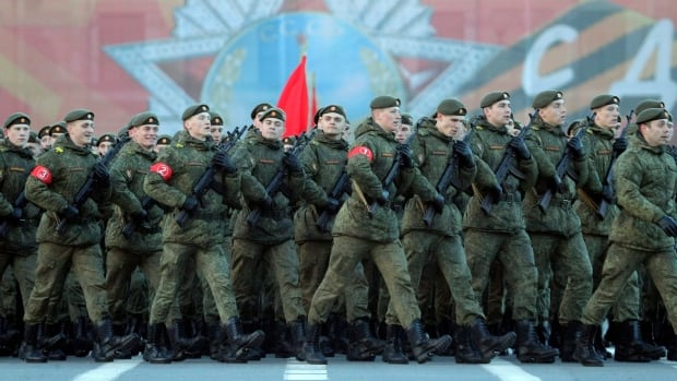 Russian soldiers march during a rehearsal for the Victory Day military parade in St. Petersburg, Russia, last week.  Russian troops will take part in a massive exercise on the border of the Baltic states this summer as Canadian troops deploy for a NATO mission.
