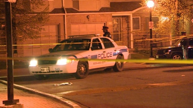 One victim was found outside a housing complex at Garden Gate Circle in Brampton late Thursday.