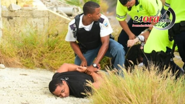 Michael Teddy Gibson was arrested in a dramatic takedown in Aruba on May 3, as seen in this photo taken by local news media.