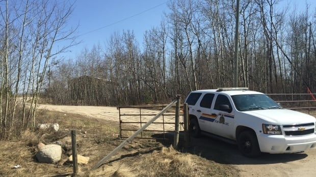 An RCMP vehicle is parked near a property in Strathcona County in April 2015 as police search a property in connection with a homicide.