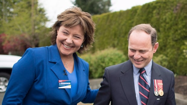 B.C. Liberal Leader Christy Clark shares a laugh with Jim Benninger during a campaign stop in Courtenay, B.C., Monday, May 8, 2017.