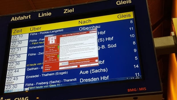 A window announcing the encryption of data including a requirement to pay appears on an electronic timetable display at the railway station in Chemnitz, Germany, on Friday. Officials are urging companies to update their operating systems immediately.