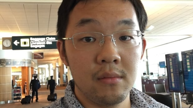 Qingyang Liu was bumped off a flight to Saskatoon from Winnipeg, while his girlfriend was allowed to take the flight.