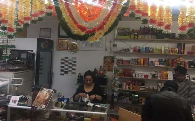 Bhima and Saroj Chhetri behind the counter of their store.