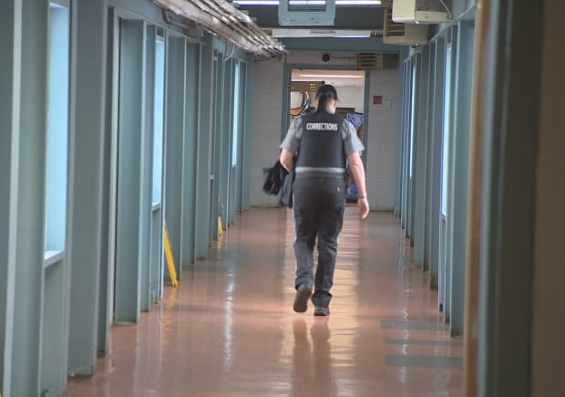 HMP corrections officer walking
