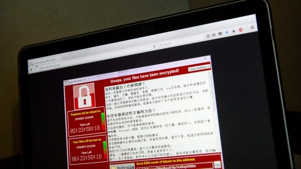 A screenshot of the warning screen from a purported ransomware attack, as captured by a computer user in Taiwan, is seen on laptop in Beijing on May 13. WannaCry was able to spread worm-like through networks of computers from an infected source.