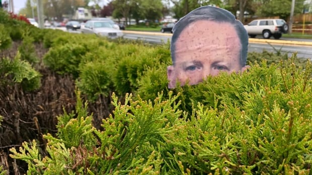 "A ""Garden Spicer"" parodying White House spokesperson Sean Spicer in a Victoria garden. The Garden Spicer is the brainchild of Lisa Kadonaga, a University of Victoria and Camosun College instructor."