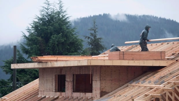 Builders work on a new home in North Vancouver in 2016. The average home price in Canada climbed by 10 per cent to $559,317 in April, the Canadian Real Estate Association says.