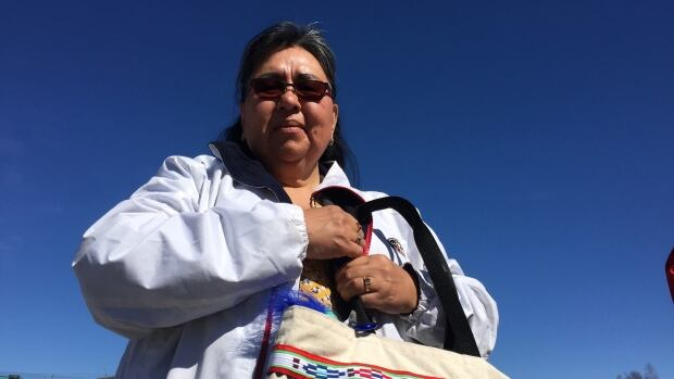 Inuvik's Darlene Allen clutches her 'lucky bag' near the Tommy Forrest Ball Park in Yellowknife. She brought the bag with her from Inuvik just hours before her big win. She intended to return home with the bagged stuffed with winnings.