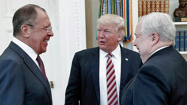 U.S. President Donald Trump speaks with Russian Foreign Minister Sergey Lavrov, left, and Russian Ambassador to the U.S. Sergey Kislyak during their meeting in the White House. Reports say Trump spilled highly classified data while bragging about the intel he receives.