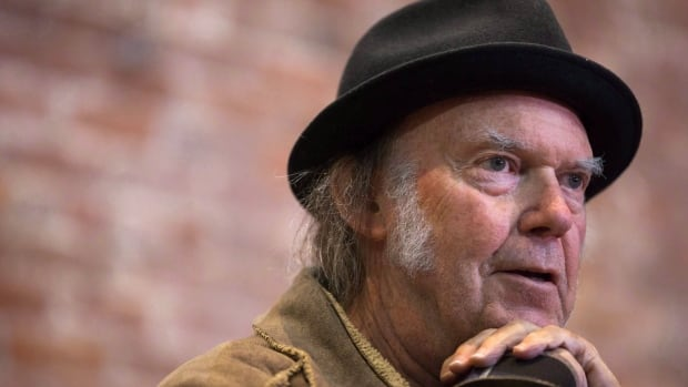 Neil Young speaks during a news conference in Vancouver, B.C., in November 2015. The Canadian musician is one of the artists being honoured this year for their musical contributions.