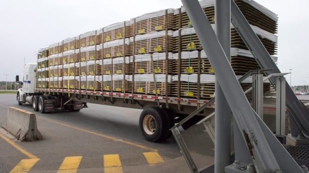 A truck carrying wood goes through the customs checkpointin Champlain, N.Y. Canadian lumber imports into the United States face new duties ranging from three to 24 per cent.