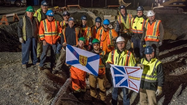 Maritime Link workers gather together in Point Aconi, N.S., after anchoring the sub-sea transmission cable from Cape Ray, N.L.