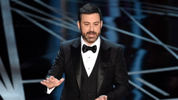 Comedian Jimmy Kimmel, seen onstage during February's Academy Awards, is coming back to host the Oscars for a second year in a row.
