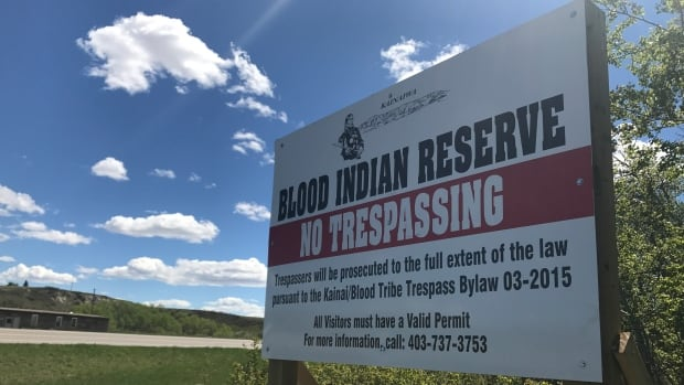 A new no trespassing sign stands at the side of a highway entrance to Blood First Nation in southern Alberta. The band council hopes to crack down on fentanyl trafficking.