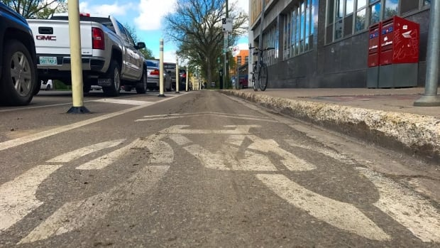 Saskatoon City Council has voted to keep protected bike lanes in the city's downtown.