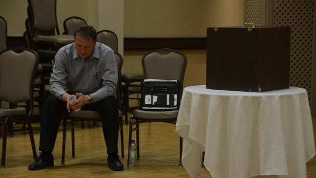 Sault Ste. Marie NDP candidate Joe Krmpotich sits next to the ballot box just before members of Steelworkers Local 2251 vote on which party their union should endorse.