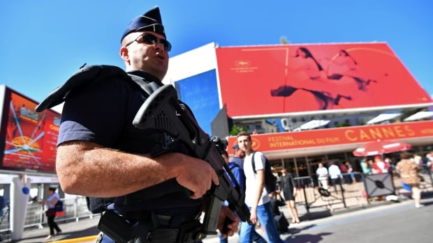 70th cannes film festival opens amid heavy security cbc news for Police cannes