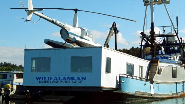 This 2014 file photo shows the Wild Alaskan, a converted crabbing boat that had been used as a strip club, moored near downtown Kodiak, Alaska. Its owner, Darren Byler, is resurrecting the controversial strip club on board his boat, billing the enterprise as a nightly protest months after he was sentenced to probation for dumping human waste from the vessel.