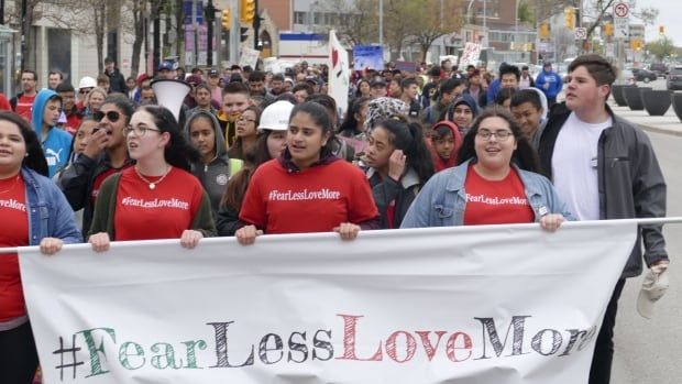 Students march through downtown Winnipeg on Wednesday to raise awareness about Islamophobia.