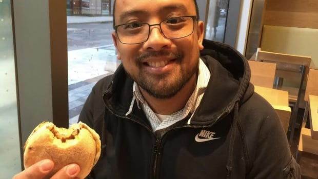 James Serreno dines on a bacon-and-egg breakfast sandwich at an A&W in Toronto.
