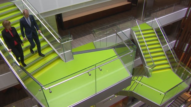 Deloitte's new Toronto office building, featuring lime green floating staircases traversing a six-storey atrium, is the biggest investment the company has made in Canada.