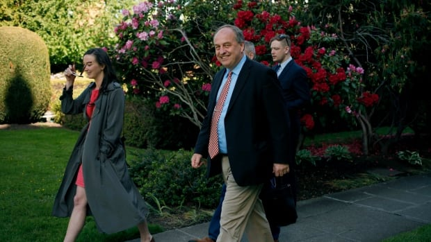 Andrew Weaver is all smiles as he leaves the B.C. legislature rose garden after speaking to media about the Green Party negotiating team.