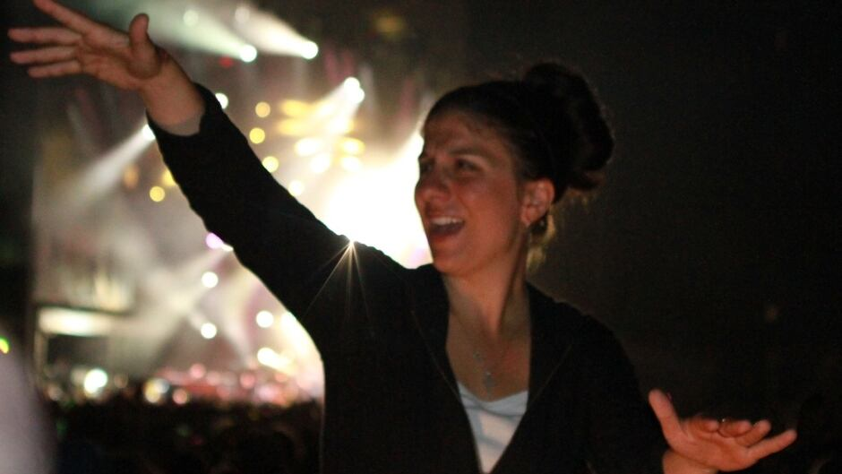 Holly Maniatty is an American Sign Language interpreter at concerts and music festivals.