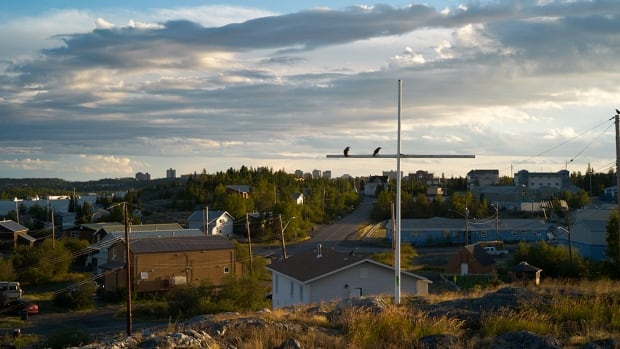 A view of Ndilo with Yellowknife in the background from a rocky hill in the community.  Residents are concerned that the community's school is near an arsenic 'hot spot'.