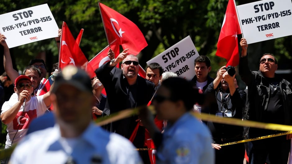 A group of pro-Erdogan demonstrators shout slogans at a group of anti-Erdogan Kurds in Lafayette Park on Wednesday. The day before, clashes between Erdogan supporters and anti-Erdogan protesters turned violent.