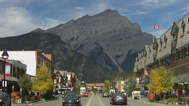 Banff is booming this summer as entry is free, but some tourism staff are left without a place to live.