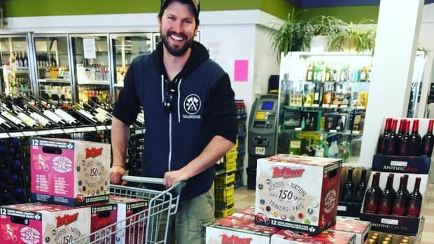 Fletcher Stevens, co-owner of the NWT Brewing Co., picks up some Red Racer 12-packs, featuring one of his very own brews, at a Yellowknife liquor store.