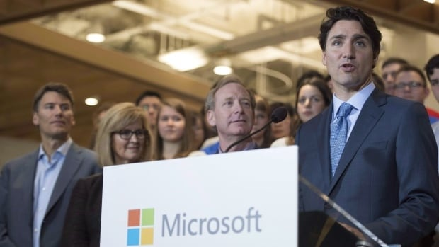 Prime Minister Justin Trudeau addresses a gathering during the opening of Microsoft's new location in Vancouver on June 17, 2016