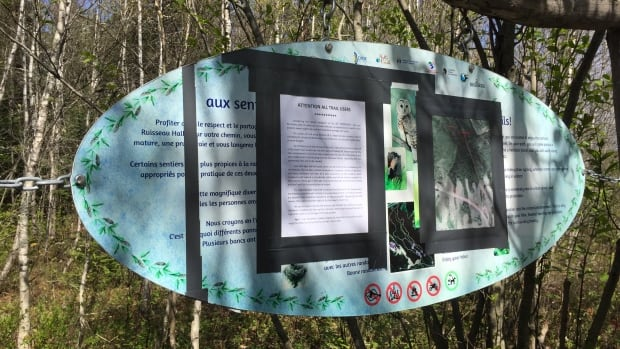 A no-trespassing notice has been taped to the entrance sign at Hall's Creek trail off Crowley Farm Road in Moncton.