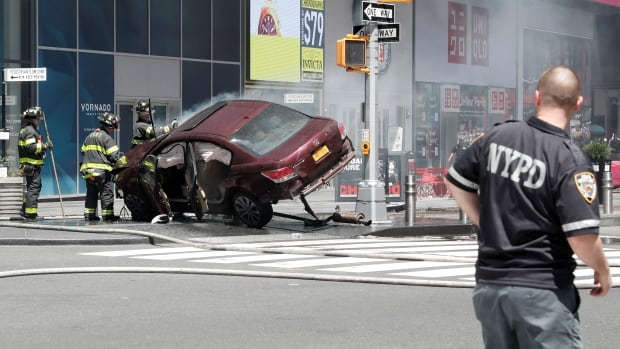 A vehicle that struck pedestrians and later crashed is seen on the sidewalk in New York City on Thursday.