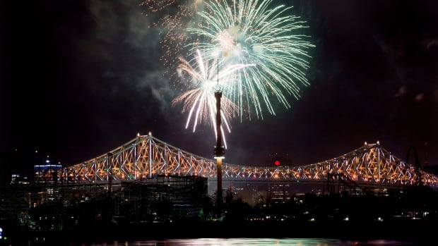 Fireworks explode over an illuminated Jacques Cartier Bridge in Montreal Wednesday night to celebrate the city's 375th birthday.