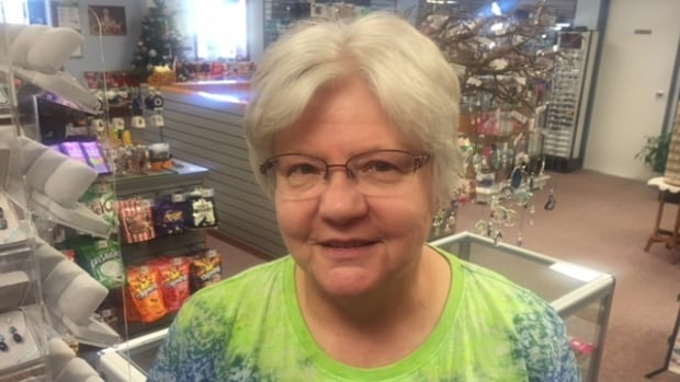 Verna Kittleson stands inside the duty free shop she runs at the U.S.-Canada border in southern Manitoba. She wonders why the Manitoba government has paid big U.S. medical bills for some of her neighbours but not her.