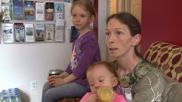 Sara Rumbolt, pictured with two of her three kids, hasn't decided whether or not her family will move back to the community once the water levels lower.