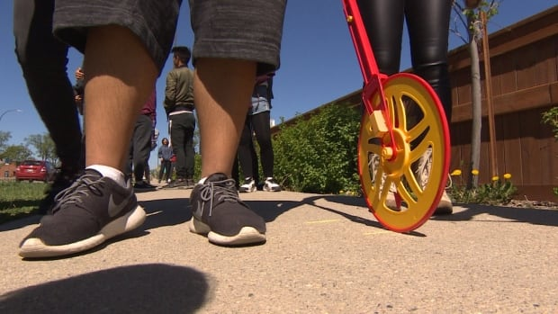 Students at Tec Voc High School in Winnipeg used math to model stopping distances for vehicles and are mapping out the results on a pair of intersections near their school using a measuring wheel.