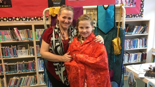 Nyla Perry, 10, right, with Janet Zarchakoff, left, Aboriginal education youth worker.  Nyla spent a year working on her hand-stitched skirt, shawl and moccasins for the annual Youth Powwow.