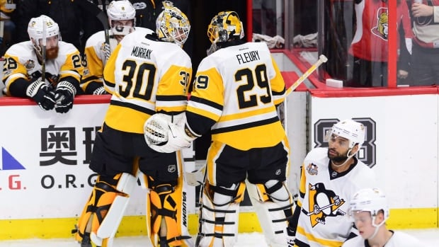 Pittsburgh Penguins goalie Marc-Andre Fleury (29) has a word with goalie Matt Murray (30) after being pulled during the first period of Game 3 of the Eastern Conference final against the Ottawa Senators in Ottawa on Wednesday. The Senators won 5-1 and hold a 2-1 lead in the series.