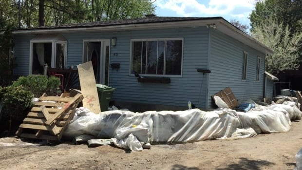 The pressure of the flooding cracked the foundation of this house on Île Bizard, but the homeowners didn't realize how dangerous it was until they'd already spent two days cleaning up inside.