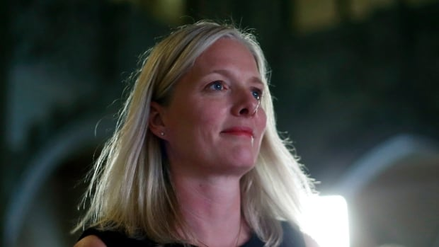 Environment Minister Catherine McKenna makes her way to the House of Commons after speaking to reporters on Thursday.