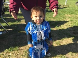 A young child ready to participate in first powwow.