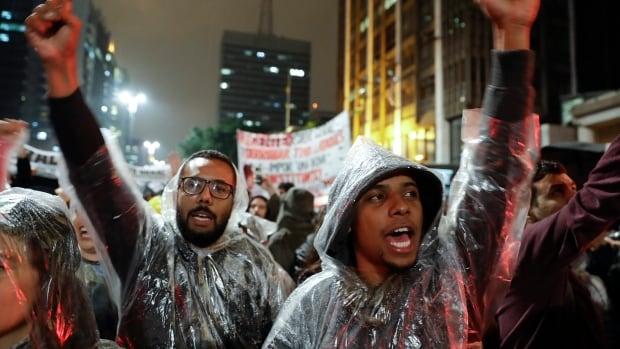 Demonstrators shout slogans against Brazilian President Michel Temer in Sao Paulo, Brazil, on Thursday.