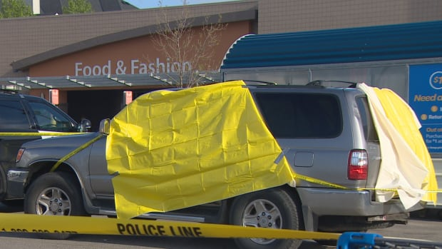 Police are investigating after a body was found in a silver SUV parked outside the McKenzie Towne Walmart Thursday afternoon.