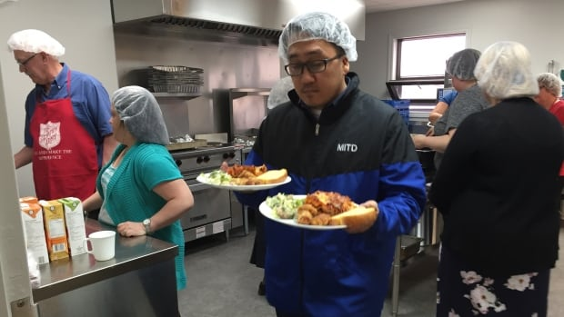 Volunteers from the Salvation Army and RBC helped cook and serve food for displaced community members.
