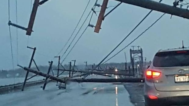 Power poles were knocked down during a huge thunderstorm in the Acadian Peninsula Thursday night.